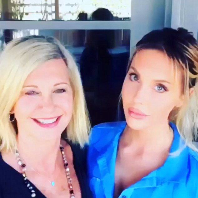 Second time lucky: In a 30-second replacement video Chloe wrapped her arm around her famous mother Olivia Newton-John as they both praised their fans for helping move their  single into the top 10