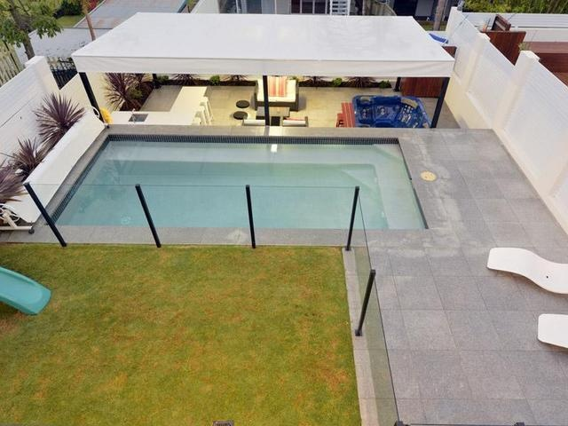 Pool Area - LOVE this design. So practical. Comes straight off outdoor area, grassed area to the left, then to the right paved area for sunbaking, pool then seperate entertaining area at back (which flows from house)