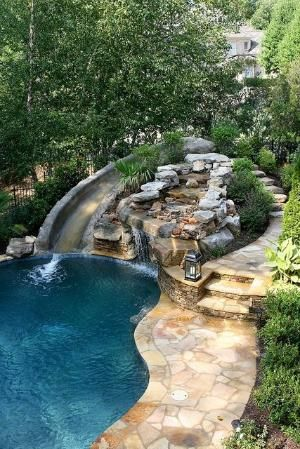 pool with slide waterfall grotto cave by vancedover, via Flickr by louise