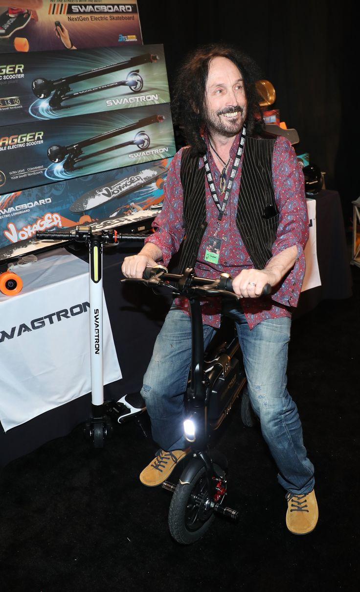 Mike Campbell from Tom Petty and the Heartbreakers () looks heart-happy on top of our SWAGTRON Swagcycle.  https://swagtron.com/product/swagcycle-e-bike-folding-electric-bicycle-by-swagtron/