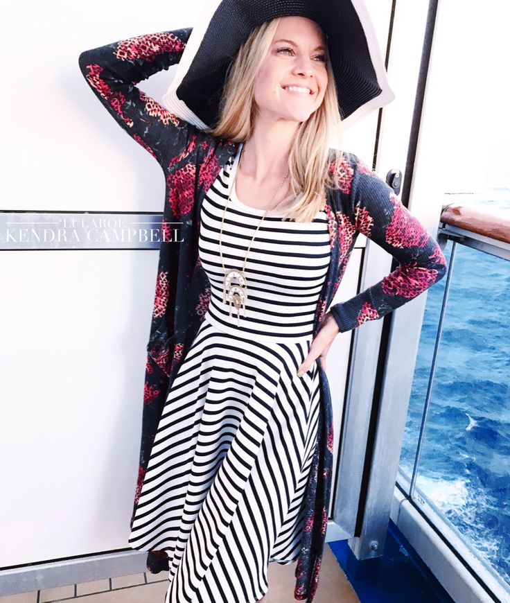 Pattern-mixing perfection: striped LuLaRoe Nicole dress with a floral LuLaRoe Sarah cardigan! My favorite evening look from our Caribbean cruise. Click for more style inspiration and to shop LuLaRoe!