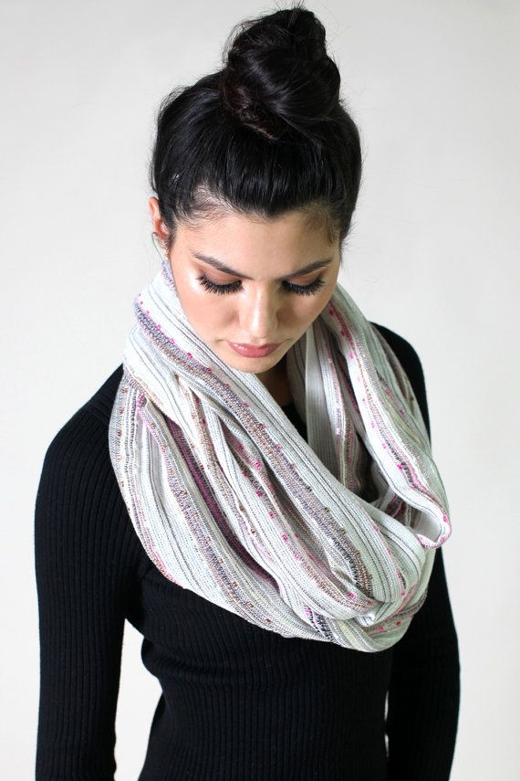 "FAST & FREE SHIPPING.  This shimmering infinity circle loop white multicolored scarf is a dazzling stunner, get showered by compliments! Pair it with a dress or jeans, go casual chic or formal stylish, this one is a work horse. Trendy infinity loop scarfs are all the rage at the moment, drape it anyway you want. Approx 35"" L X 27"" W inches loop, total length 70"" inches without loop. Soft Rayon blended with metallic gold threads. Colors may vary slightly in each scarf due to hand-dye proce..."