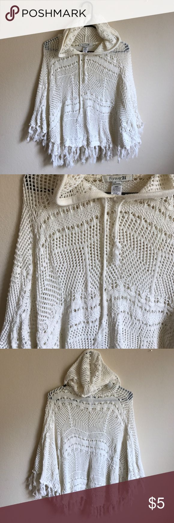 Crochet hooded poncho Worn, loved, and taken care of!! Crochet poncho with a hood!! 😍😍😍 great as a cover up or just with shorts. Forever 21 size L. Fringed detail along hem. Forever 21 Sweaters Shrugs & Ponchos