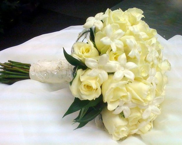 Bridal bouquet of white roses and #Stephanotis