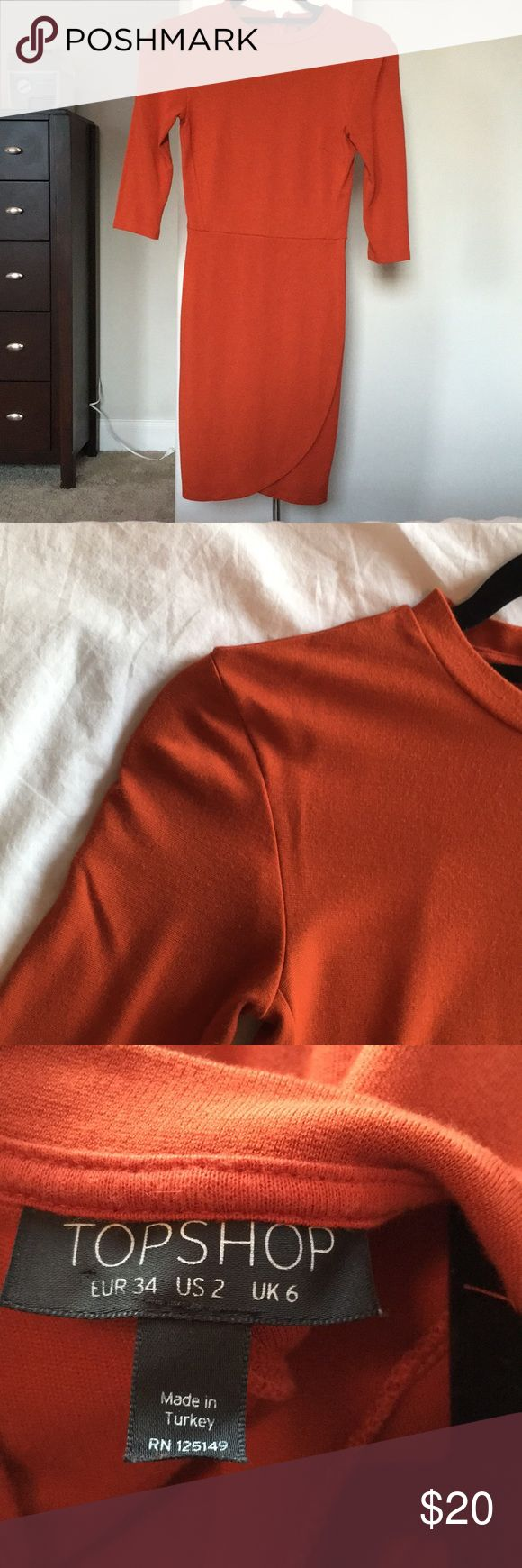 Tulip Skirt Bodycon Dress Comfortable & Flattering Bodycon Dress! A burnt orange color that is sure to turn heads! Hits at about mid thigh. Worn 3 times. Non-Smoking Environment. 3/4 Sleeve Topshop Dresses Long Sleeve
