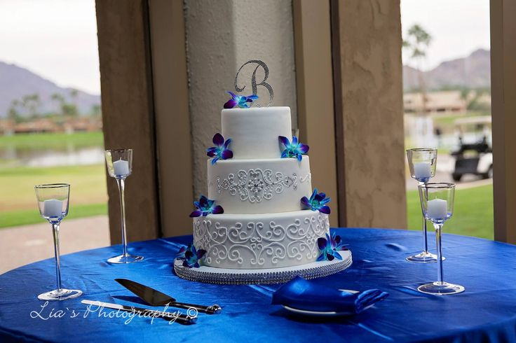 Beautiful, Elegant Royal Blue and White Wedding Cake, Round 3 tier white wedding cake with royal blue orchids, bling & scrolls by www.myloveofcake.com Best Arizona wedding cakes!