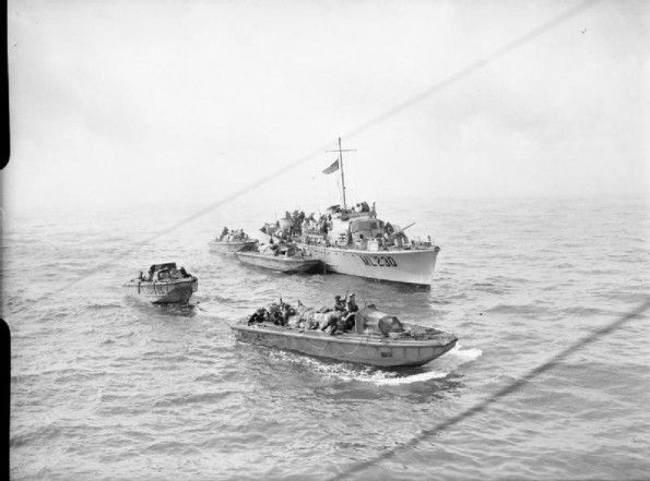 AUG 19 1942 Operation Jubilee – the raid on Dieppe A naval motor-launch seen with four of the landing craft personnel (large) used during the Combined Operations daylight raid on Dieppe. The landing craft are numbered (left – right) LCP (L) 85, LCP (L) 41, number not visible and R 145.