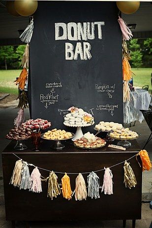 A donut display: | 23 Brilliant Wedding Bars From Couples Who Dared To Dream