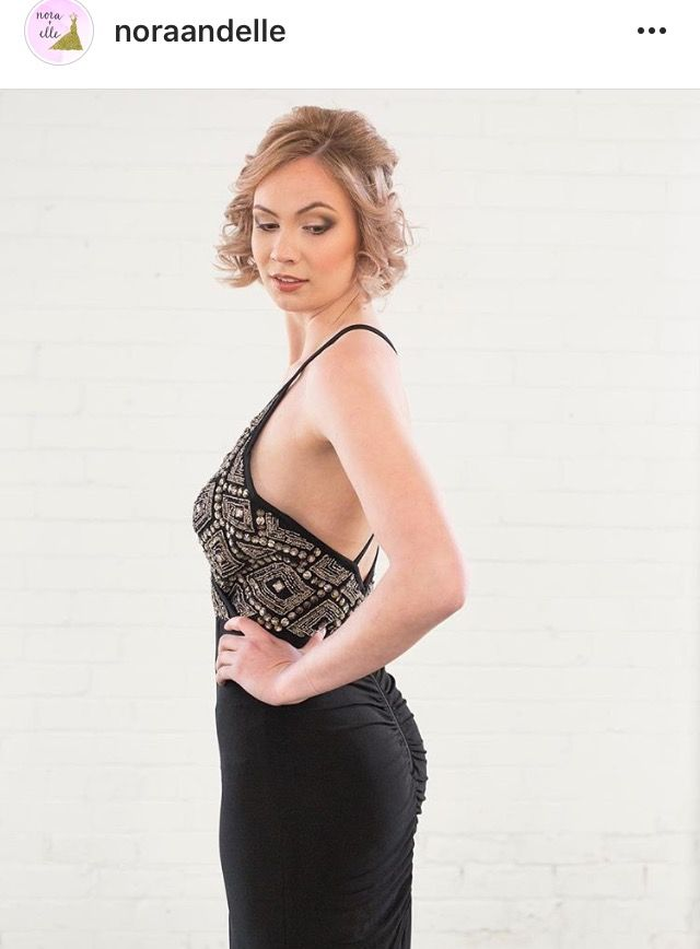 Stunning and Sexy. Black slinky dress with detailed beading. Available at Nora and Elle.