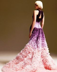 this shows rhythm through gradation and the repeating pattern of the texture of the dress.