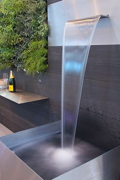 Cascading Water Blade installed in a contemporary garden setting. Architectural Landscape Design