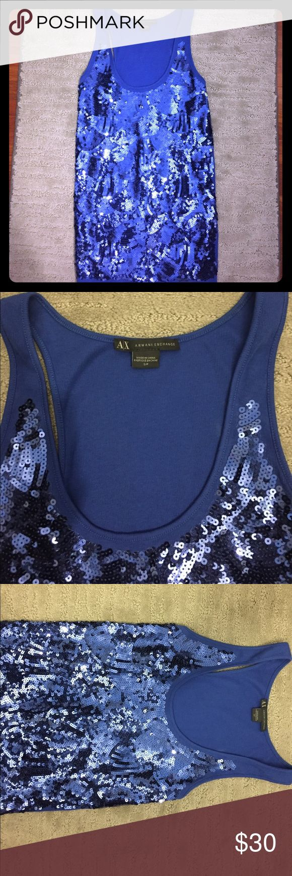 Armani Exchange sequin top Stunning Armani Exchange sequin tank top. The entire front of tank is covered in beautiful deep blue sequins that catch the light and really looks amazing for any special night out. It looks amazing with jeans or a black leggings and some heels. The scoop neck is flattering and allows room for showcasing your jewelry! Barely worn (2 times) and in mint condition. This top is a size s/p. It is 95% cotton and 5% spandex.  A gorgeous addition to any closet 😀! Armani…