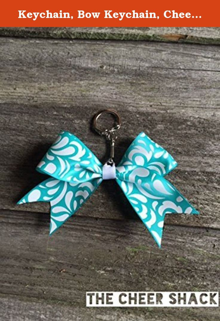 """Keychain, Bow Keychain, Cheer Bow Keychain. Cheer bow keychain. 1.5"""" grosgrain ribbon. Embellished with The Cheer Shack's signature rhinestone. Great for decorating backpacks, bags, etc. Print design and color on each bow may vary."""