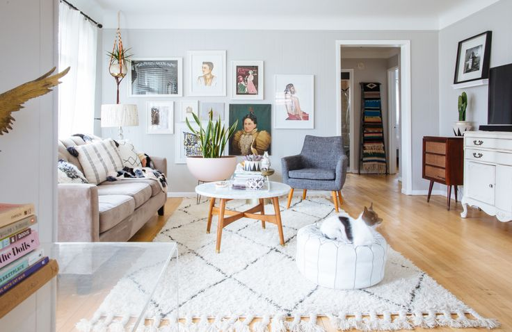 The coffee table is West Elm, the chair is from Urban Outfitters, the sofa is from Macy's and the rug was bought at RugsUSA.