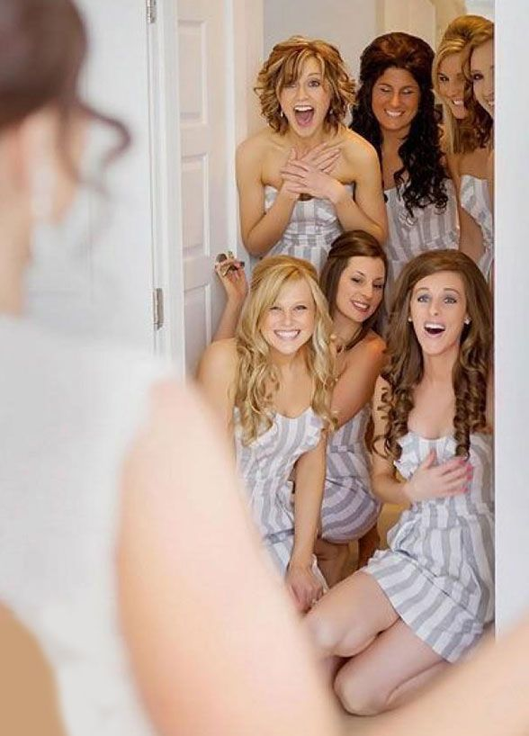 There's no doubt that your bridesmaids will be oohing and ahhing as soon as they get a glimpse of you in your wedding dress. Make sure to capture the moment! Bridesmaids, Bridal Party, Bridesmaid Photos, Wedding Photo Ideas