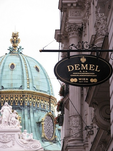 Dome of the Hapsburg Palace in Vienna and the Demel Cafe, famous for their apple strudel and tortes.