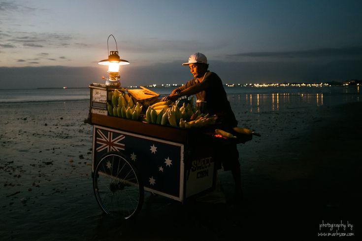 A Balinese corn vendor at Jambaran beach taken just after sunset.