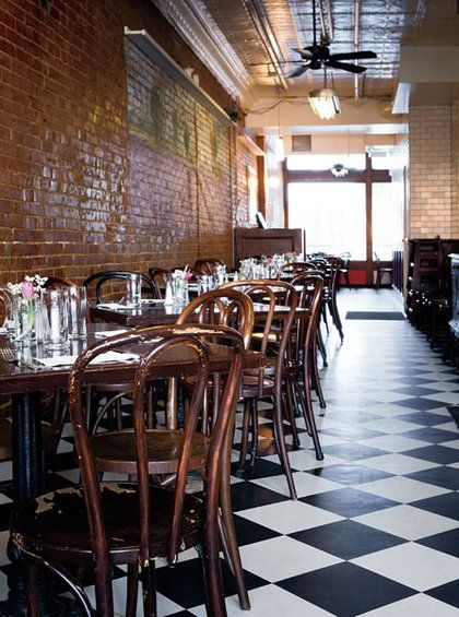 french bentwood cafe chairs beige accent chair black-and-white tile floors, brick walls, a tin ceiling and lend the space an ...