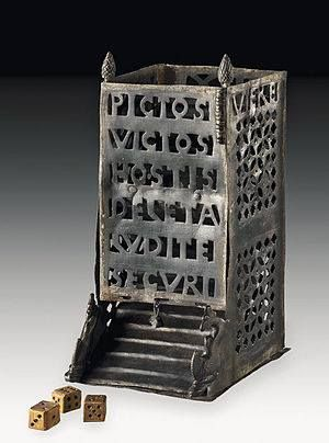 The Vettweiss-Froitzheim Dice Tower is a Roman artifact formerly used in the playing of dice games. It dates to the fourth century AD and was apparently presented as a gift. It bears two Latin texts. The longer text commemorates a military defeat of the Picts. The shorter text wishes good luck to the unnamed recipients of the item.