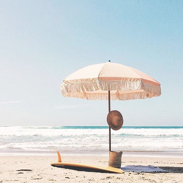Sunday supply co beach umbrella. summer day at the beach.                                                                                                                                                                                 More