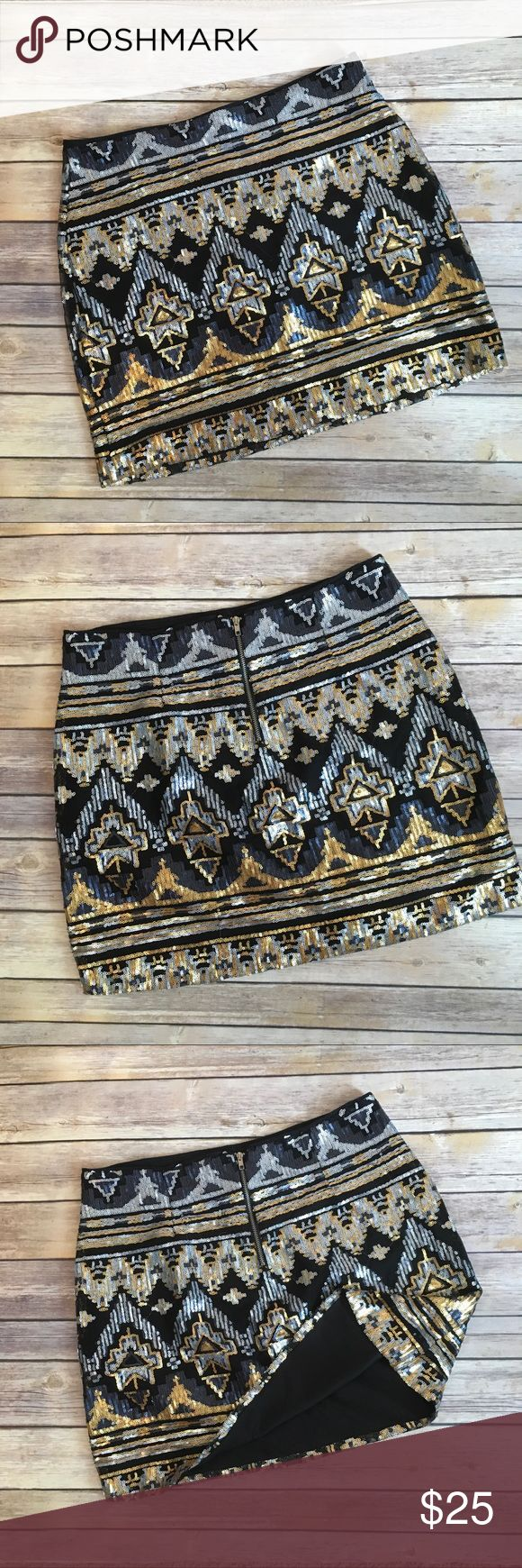 Forever 21 Aztec Sequin skirt Forever 21 Aztec Sequin skirt. Silver, gold and black. EUC. Size large. Runs small see photo with measurements. Forever 21 Skirts Mini