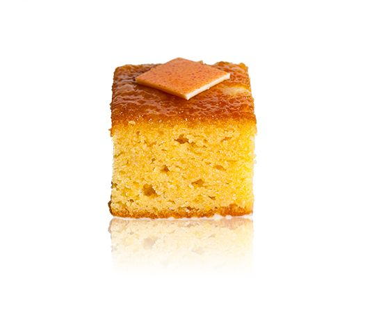 Torta Di Arancia - A thin white chocolate base, moist flourless almond and orange cake, covered in a glaze