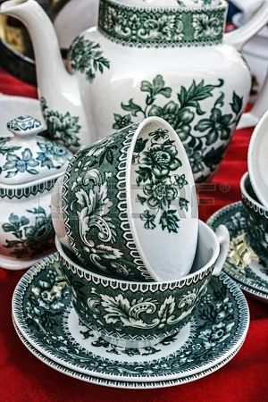 Old ceramic cups with green paintings applied
