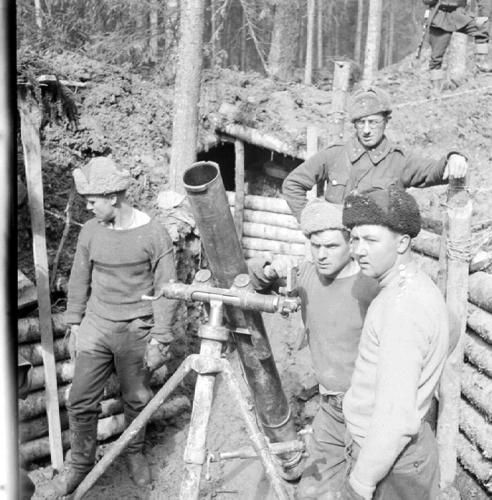 Mortar crew with their 120mm mortar.