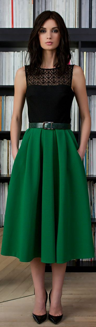 Women's fashion   Black lace top, green pleated midi skirt, forest green belt, black heels.