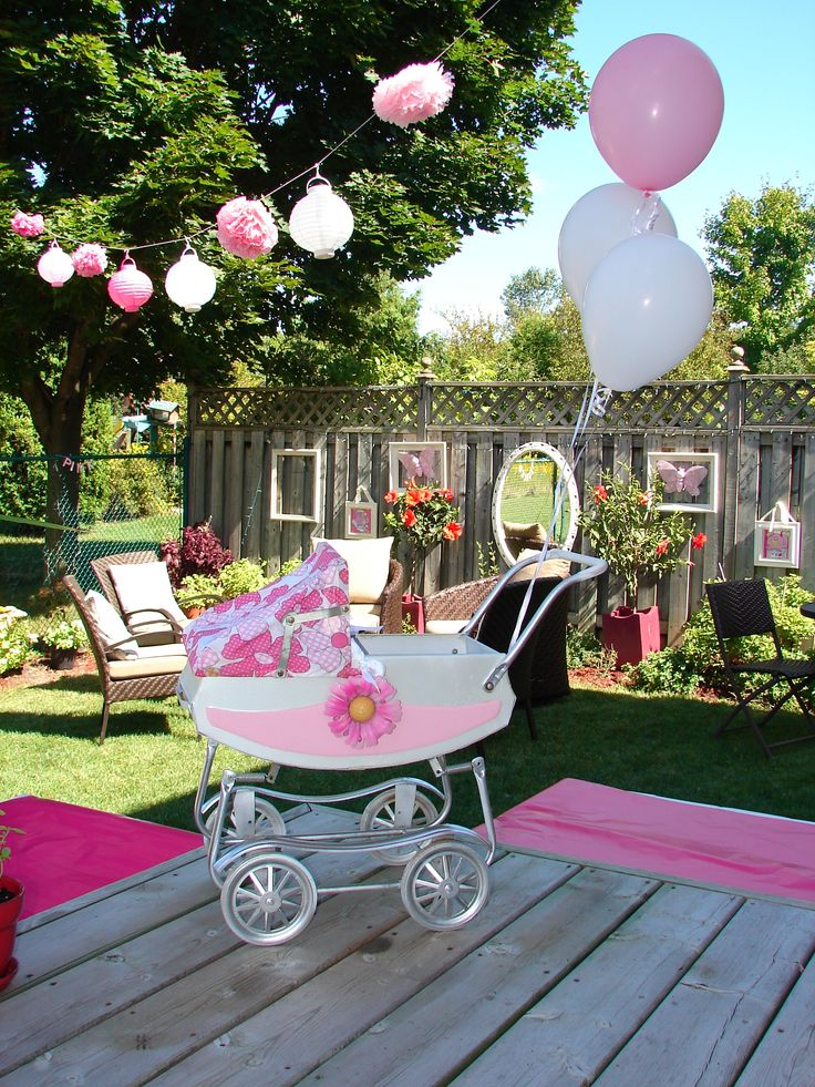 painted my old carriage for decoration and hung lanterns in pink and white