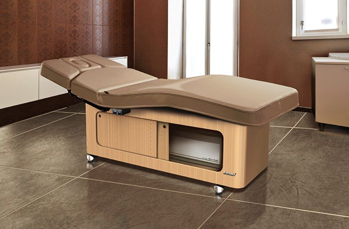 Spa Treatment bed with storage. Oak finish and  brown upholstery.