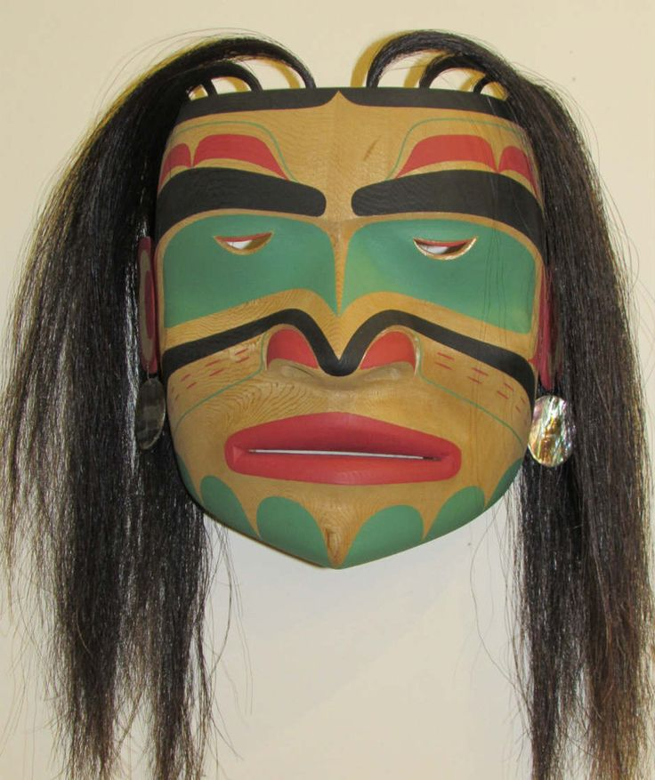 "This mask was created by Master Carver Calvin Hunt. Calvin has both Kwagiulth and Nuu-chah-nulth ancestry, and currently lives in Fort Rupert. This portrait mask represents a young woman in a family. Carved in Feb. 2002.  Carved out of red cedar, made with acrylic paint, horse hair and abalone earrings. 9 1/2"" x 5 1/4"" x 9"" #Northwest #Coast #FirstNations #AboriginalBC"