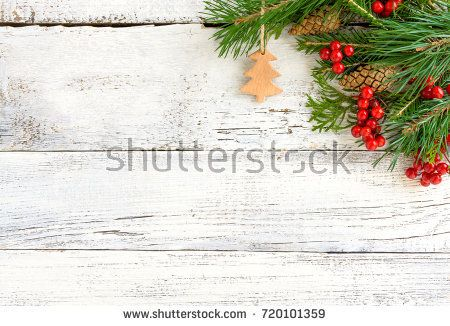 Christmas wooden background with fir tree red berries and cones
