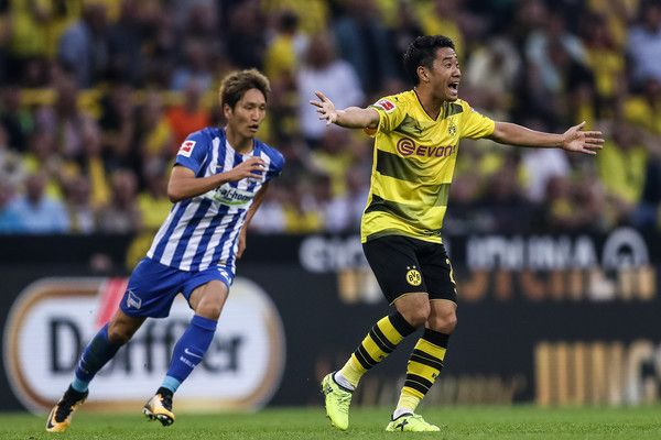 Shinji Kagawa Photos - Shinji Kagawa of Dortmund reacts during the Bundesliga match between Borussia Dortmund and Hertha BSC at Signal Iduna Park on August 26, 2017 in Dortmund, Germany. - Borussia Dortmund v Hertha BSC - Bundesliga