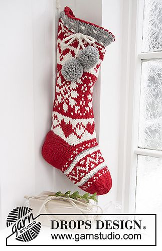 "DROPS Christmas: Knitted DROPS Christmas sock with Nordic pattern and pompoms in ""Nepal"""