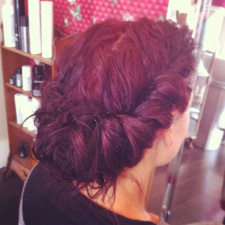 Modern twist on a vintage hair up. Twisted,braided thick curly hair. Hair up for a bridesmaid. Updo for a wedding.