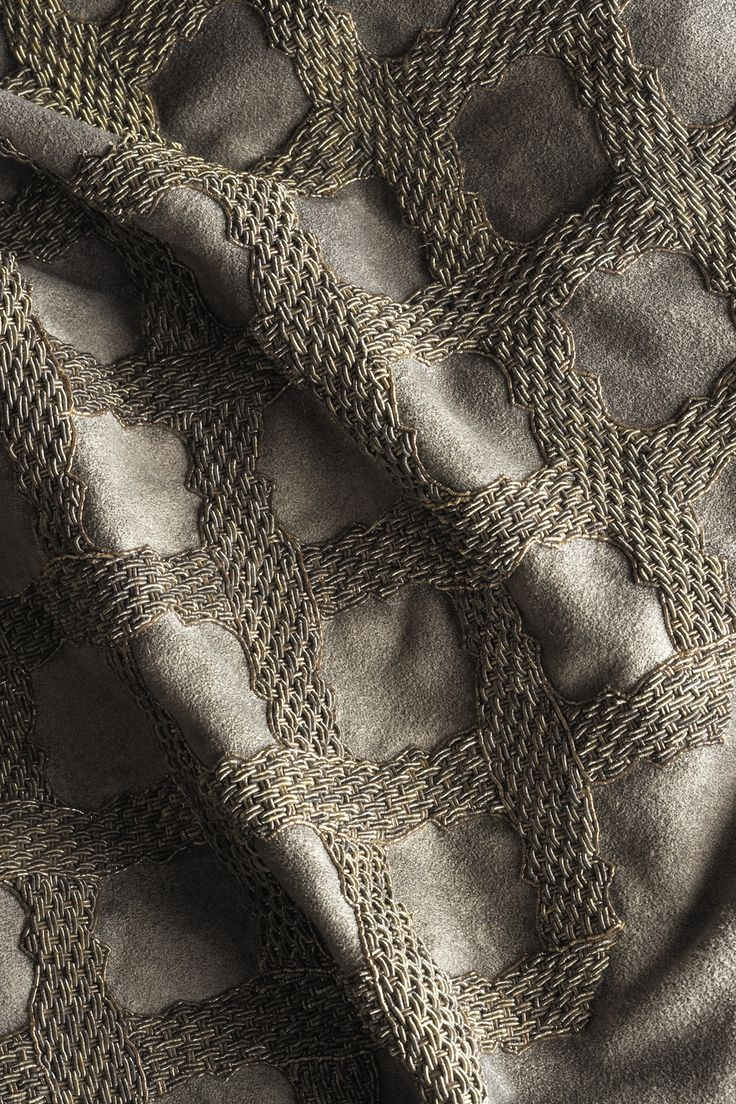 Otello...even the name inspires grandeur. This hand embroidered fabric is only one of the many opulent designs from Beaumont & Fletcher. Shown on Antique suede.