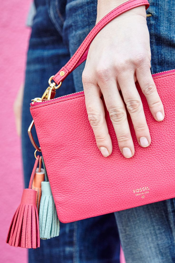 See the pomegranate wristlet clutch and tassel charm? That's our tried-and-true way to color clash.