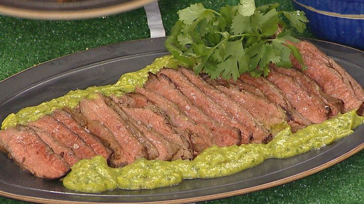 Swap greasy tailgating food with healthier grilled flank steak with avocado salsa verde and crispy spiced oven fries with Sriracha ketchup
