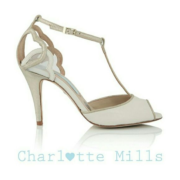 "Charlotte Mills Amelia Heart bridal heel shoes Discontinued shoes with crossed out labl and marked bottom sole  Amelia ivory and gold leather hearts t-bar heels by Charlotte Mills Layers of hearts grace these t-bar wedding sandals, with slender straps and a classic silhouette imbuing a polished modern beauty. Made with a mix of ivory leather and champagne metallic dusted suede. Features Charlotte's signature silver sixpence, with the left shoe in every pair   Heel height 3""  insole 10""…"