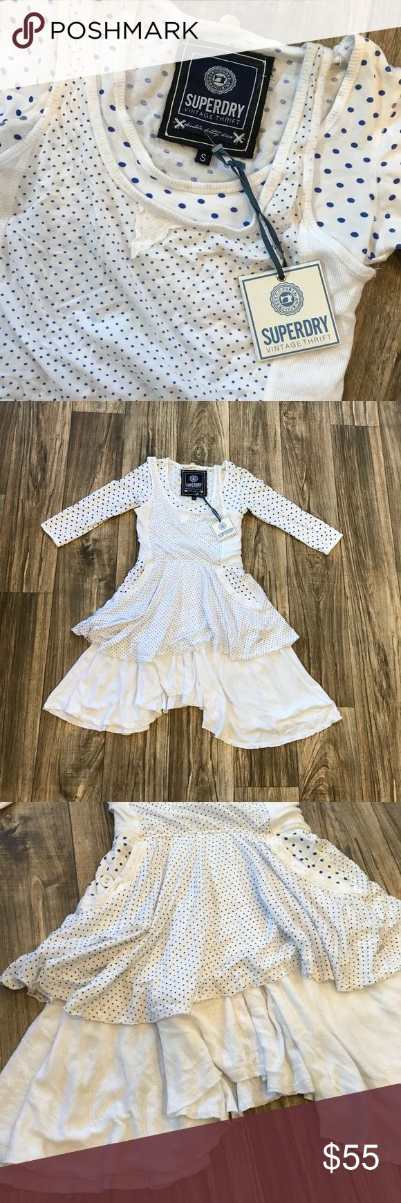 Super dry dress NWT supper dry vintage .dress so cute white with polka dots apron like style on front with pockets . The skirt is longer on either side shorter in the middle for sorta a boho look no flaws super cute for spring Superdry Dresses