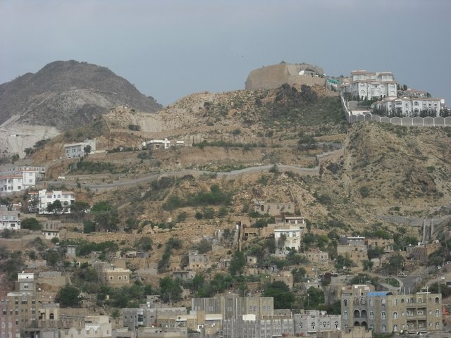 Taiz in Yemen.  Ta'izz has a dramatic setting where the roads run up and down the mountain sides. Above the city rises the 3,006 metres high Sabir Mountain. The city is famous for the ancient Jewish Sharab.