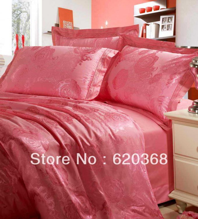Pink bedding and satin pillowcase.