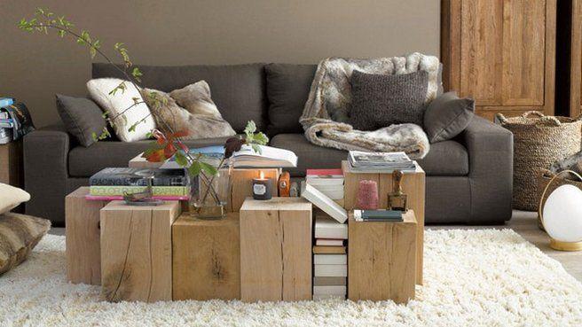 Cocooning Du bois, des livres, des canapés et des fauteuils confortables sur lesquels se trouvent des coussins et des plaids, tous les éléments sont rassemblés pour un salon d'ambiance cocooning.