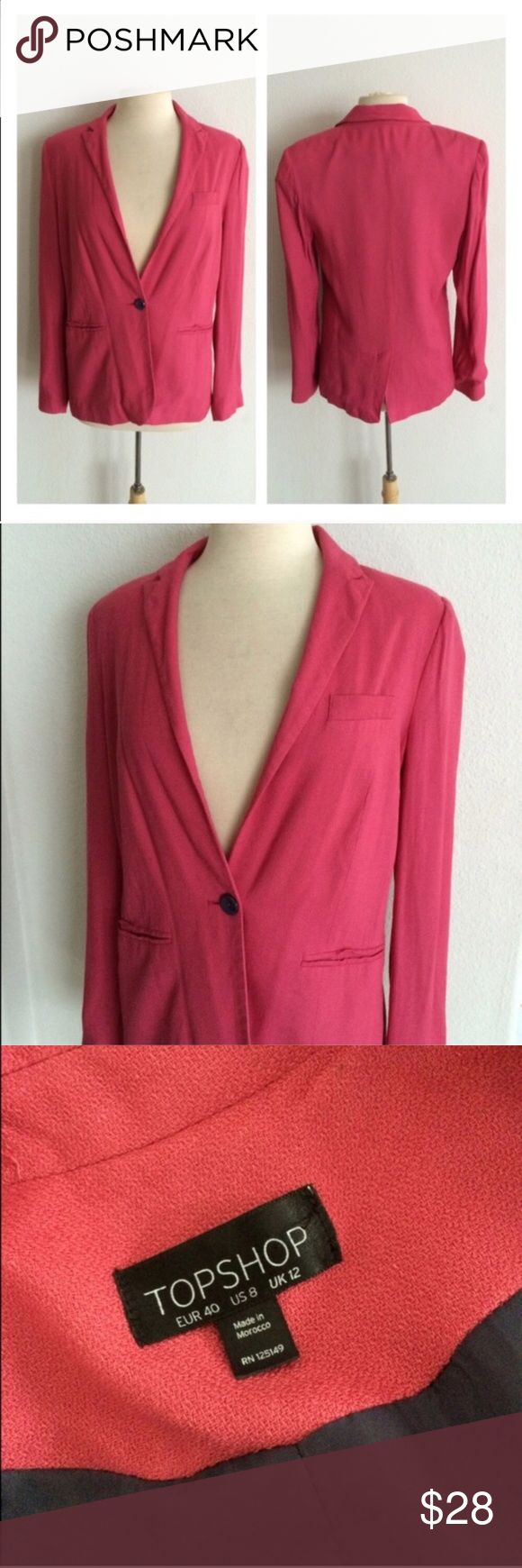 """Topshop pink blazer Topshop pink blazer. Size 8. Measures 27"""" long with a 38"""" bust. Front pockets aren't functional. Lightly padded shoulders. Plain charcoal gray lining. Exterior is 100% viscose and the lining is 100% polyester. Single button closure. Very good used condition!  🚫NO TRADES🚫 💲Reasonable offers accepted💲 💰Ask about bundle discounts💰 Topshop Jackets & Coats Blazers"""