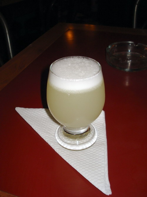 Pisco sour, another Chilean classic. This cocktail is made with pisco, sort of a grape brandy that originated in Chile with lemon juice and sugar