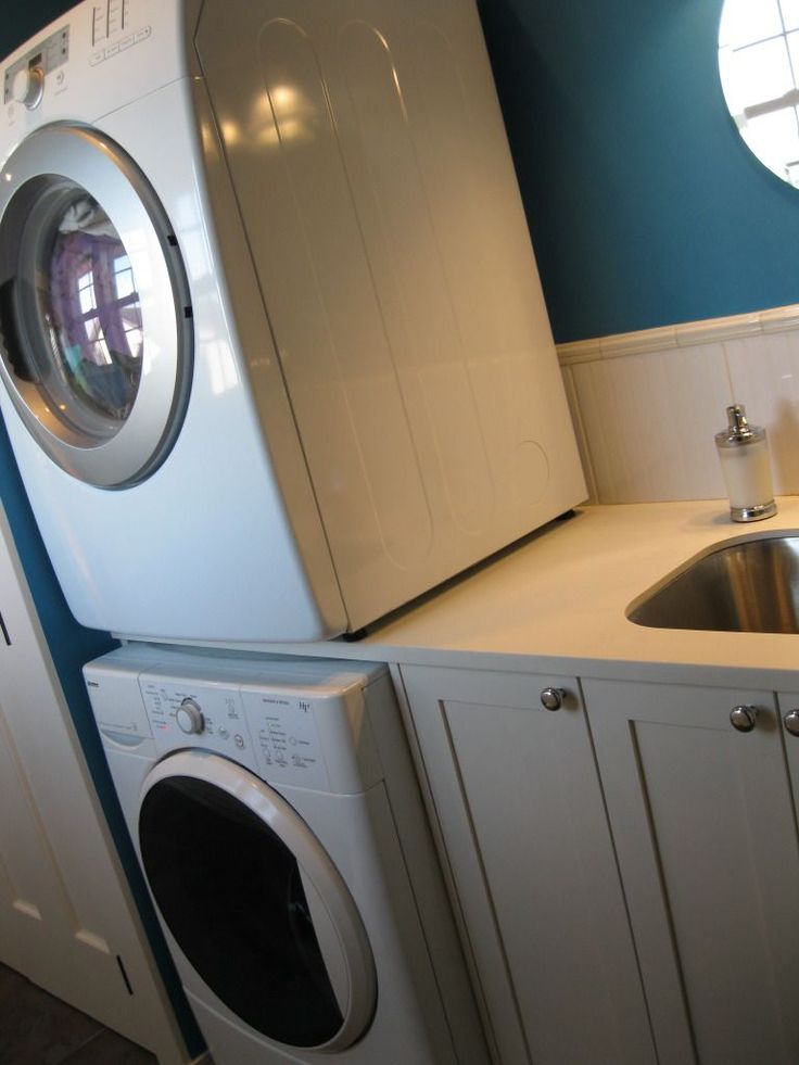 Love the easy built-in utility sink and stacked washer/dryer for a small laundry room.