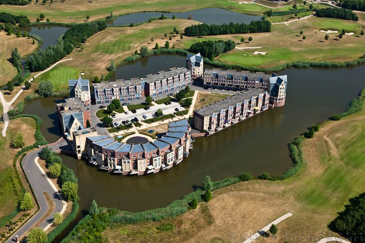 Sjoerd Soeters and Paul van Beek, Haverleij Housing project, 1999-now: Nine Modern-Day Castles in 's-Hertogenbosch, The Netherlands. Photo by Siebe Zwart.