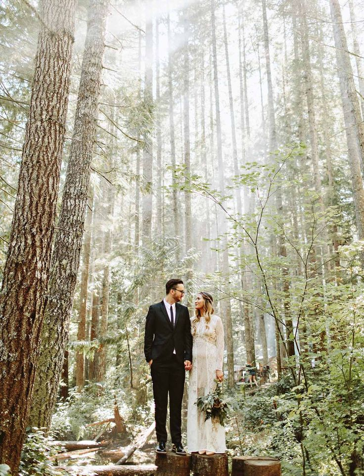 A wedding in the woods; encompassed by a canopy of tall evergreen trees, this couple said I do in the Pacific Northwest.