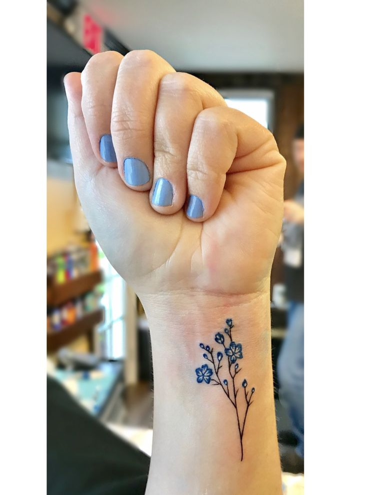 Small Classy Tattoo Ideas: Wildflower Tattoo On Wrist. Small, Dainty Tattoo With